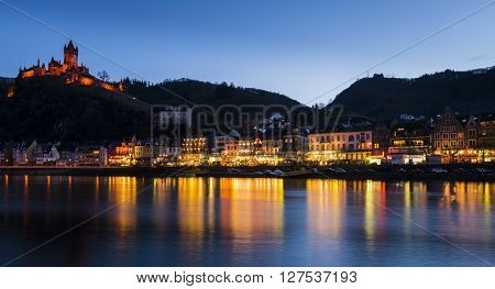 Cochem, Germany - March 28, 2016: Cochem at the Mossele in Germany at night with lights and a great castle Reichsburg