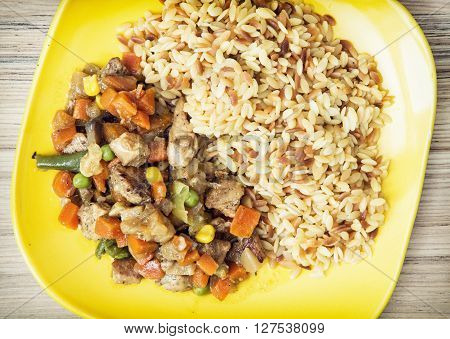 Chicken meat with fried rice and steamed vegetables. Serving food. Food theme. International cuisine. Lunch menu.