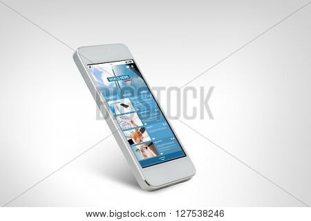 technology, business, electronics, internet  and mass media concept - white smarthphone with world news web page on screen