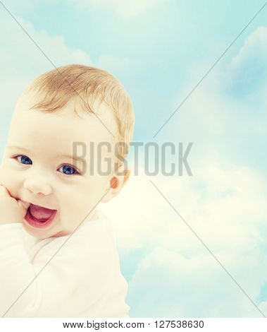 child, people and happiness concept - adorable baby boy