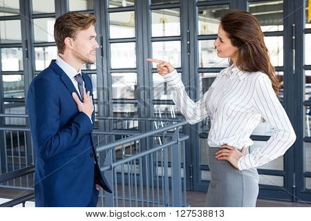 Businessman and businesswoman having a discussion in office
