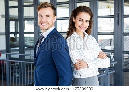 Portrait of businessman and businesswoman smiling in office
