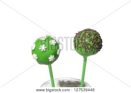 Two tasty colored cakepops on isolated background