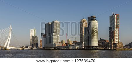 Rotterdam, The Netherlands - February 29, 2016: Wilhelminapier in Rotterdam with skycrapers offices Erasmus Bridge and Hotel New York.
