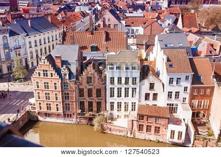 Ghent, Belgium - April 12, 2016: Aerial panoramic cityscape view of Ghent, Belgium with canal, traditional medieval houses