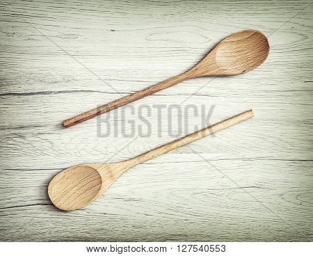 Two wooden spoons on the white background. Kitchen equipment. Wooden objects. Kitchen tool. Close up scene.