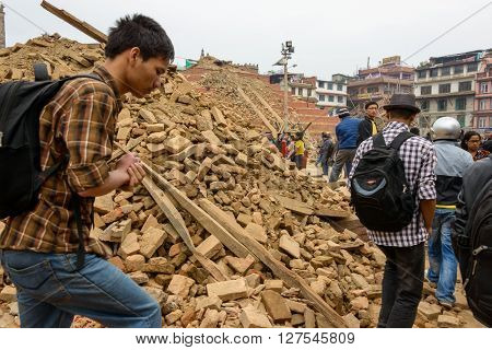 KATHMANDU, NEPAL - APRIL 26, 2015: Durbar Square, a UNESCO World Heritage Site, is severly damaged after the magnitude 7.8 earthquake on 25 April 2015.