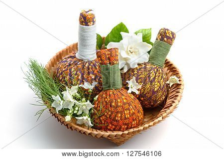 Spa herbal Compressing ball with Thai flower on white background.