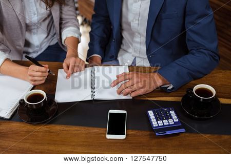 People discussing business in a cafe