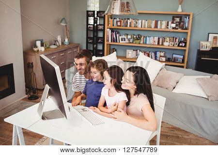 High angle view of happy family using computer at home