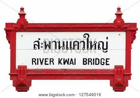 River Kwai Bridge sign at the adjacent railway station Kanchanaburi Thailand. Isolated image.