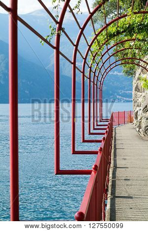 closeup photo of a red arch passage in Varenna near Lake Como Italy