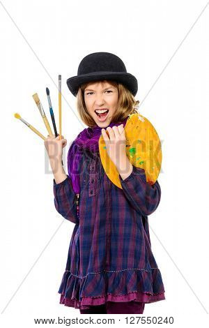 Expressive artist girl with her brushes and palette of colors. Hobby, occupation. Isolated over white.