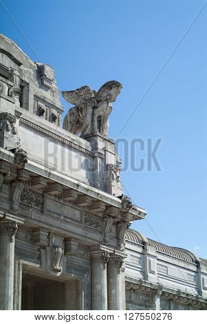 Milan, Italy - September 5th 2015: closeup photo of the facade of the Milano Centrale railway station against blue sky.