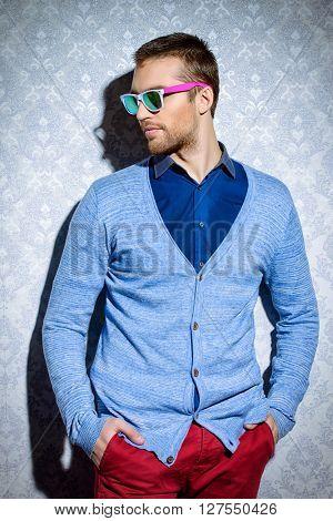Men's beauty, fashion. Elegant good looking young man.