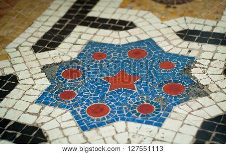 Milan, Italy - September 5th 2015: closeup photo of floor mosaic in the Galleria Vittorio Emanuele II in Milan.