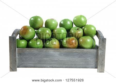 fresh green apples heap in vintage grey box ready to sell isolated on white background