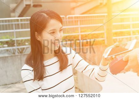 Woman pay on pos machine