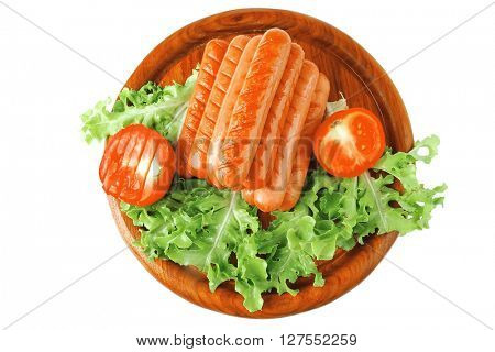 grilled pyramid of beef sausages on wooden plate