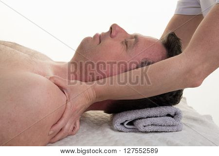 Facial And Cranial Osteopathy Therapy In A Medical Room