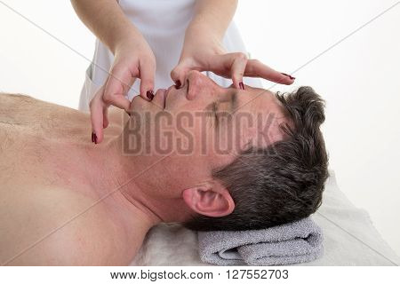 Osteopathy Therapy In A Medical Room On Patient
