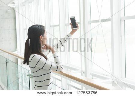 Woman take photo by cellphone