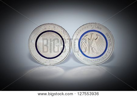 First German five euro coin with blue polymer ring