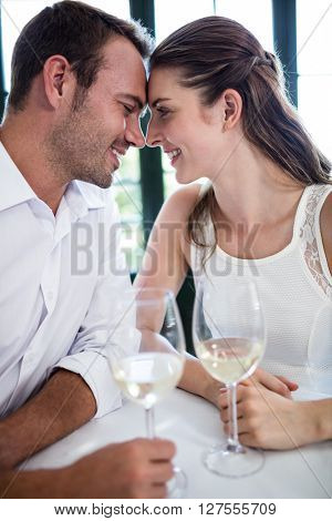 Couple sitting face to face in a restaurant on a date