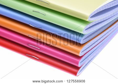 Stack of exercise books isolated on white background