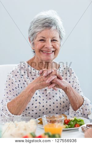 Elderly woman having breakfast in the morning