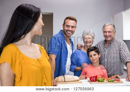 Happy family standing in the kitchen at home