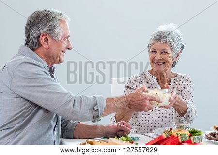 Elderly couple having breakfast in the morning