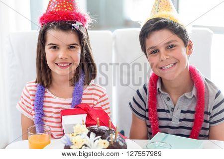 Siblings celebrating birthday at home