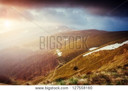 Great view of the snow hills which glowing by sunlight. Dramatic and picturesque scene. Location place Carpathian, Ukraine, Europe. Beauty world. Retro and vintage style. Instagram toning effect.