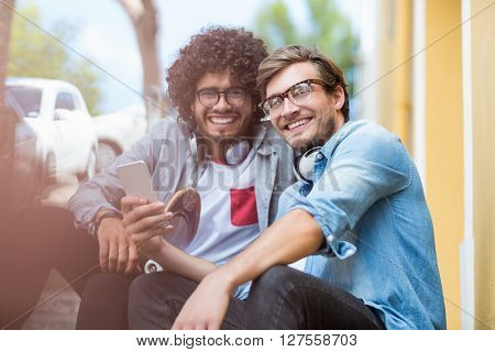 Portrait of friends using mobile phone