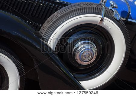 Color image of the spare tire of a vintage car.
