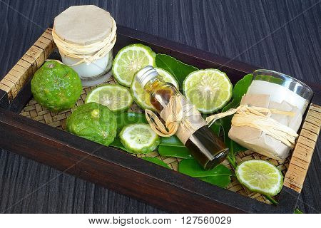 Thai herbal for spa therapy with Kaffir Lime on wooden background