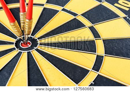 One target with three arrows hitting the bullseye (center)(goal). Success business strategy and marketing concept abstract success business background