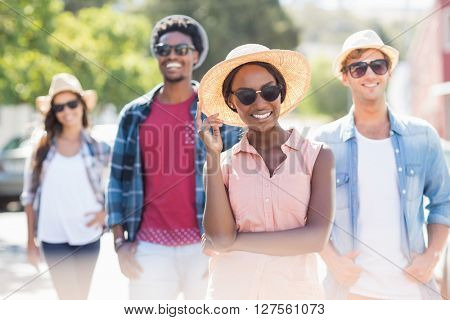 Friends in sunglasses smiling at camera