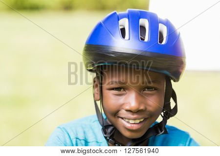 Young boy wearing his helmet at park