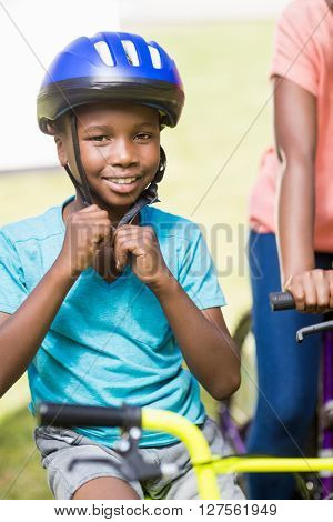 Young man wearing his helmet at park