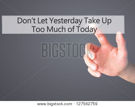 Don't Let Yesterday Take Up Too Much Of Today - Hand Pressing A Button On Blurred Background Concept