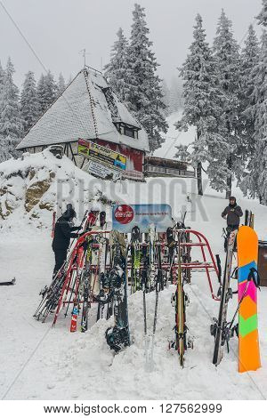 Poiana Brasov Romania - February 5 2016: Skiers leave their skis against the racks while relaxing dining and drinking at Postavaru chalet at 1604m altitude in Postavaru Mountain Poiana Brasov.
