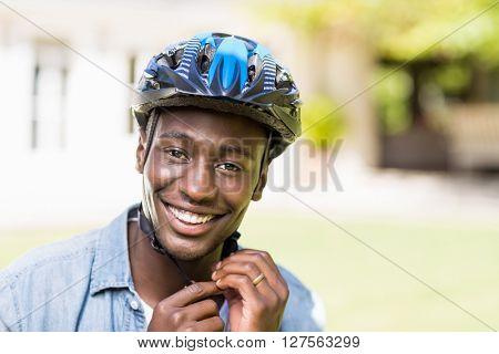 Happy man using his helmet at park