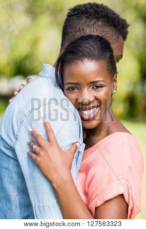 Happy couple having hug at park