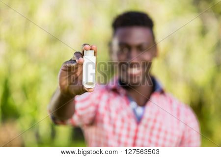 A man is showing an object
