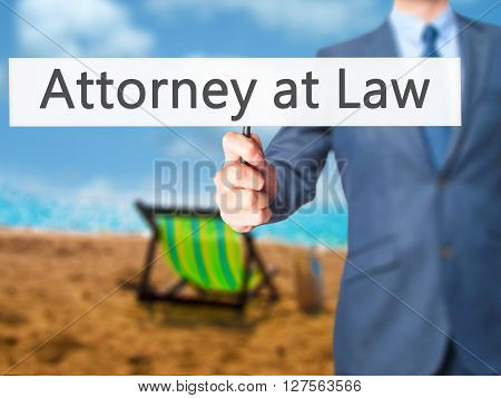 Attorney At Law - Businessman Hand Holding Sign