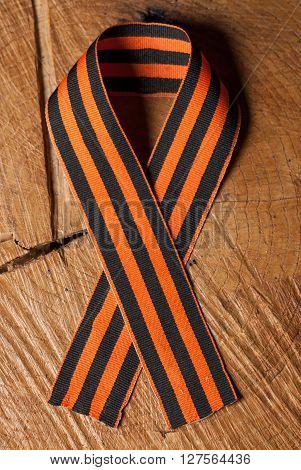 Victory day: St. George ribbon on wooden background