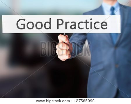 Good Practice - Businessman Hand Holding Sign