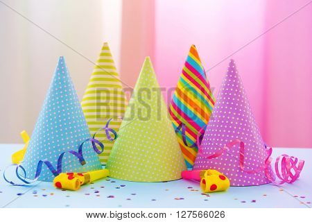 Party hats on bright background